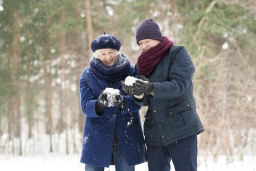 senior couple bundled up on a snowy day