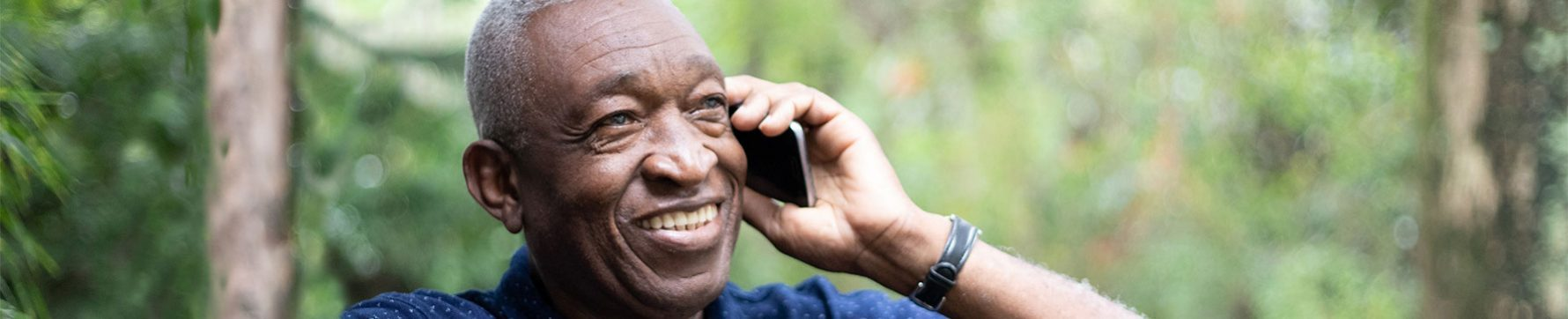An elderly man talking on his cell phone