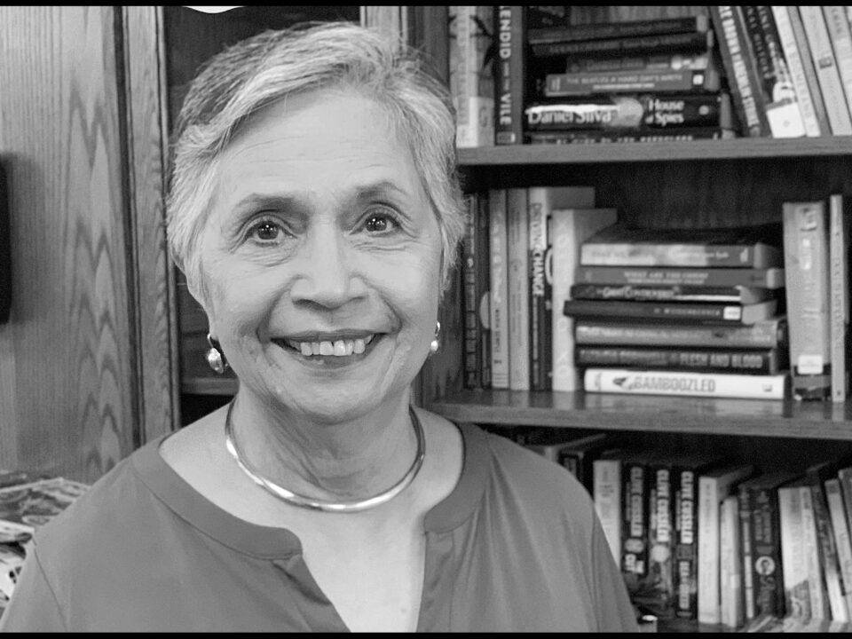 Senior woman smiling in a library