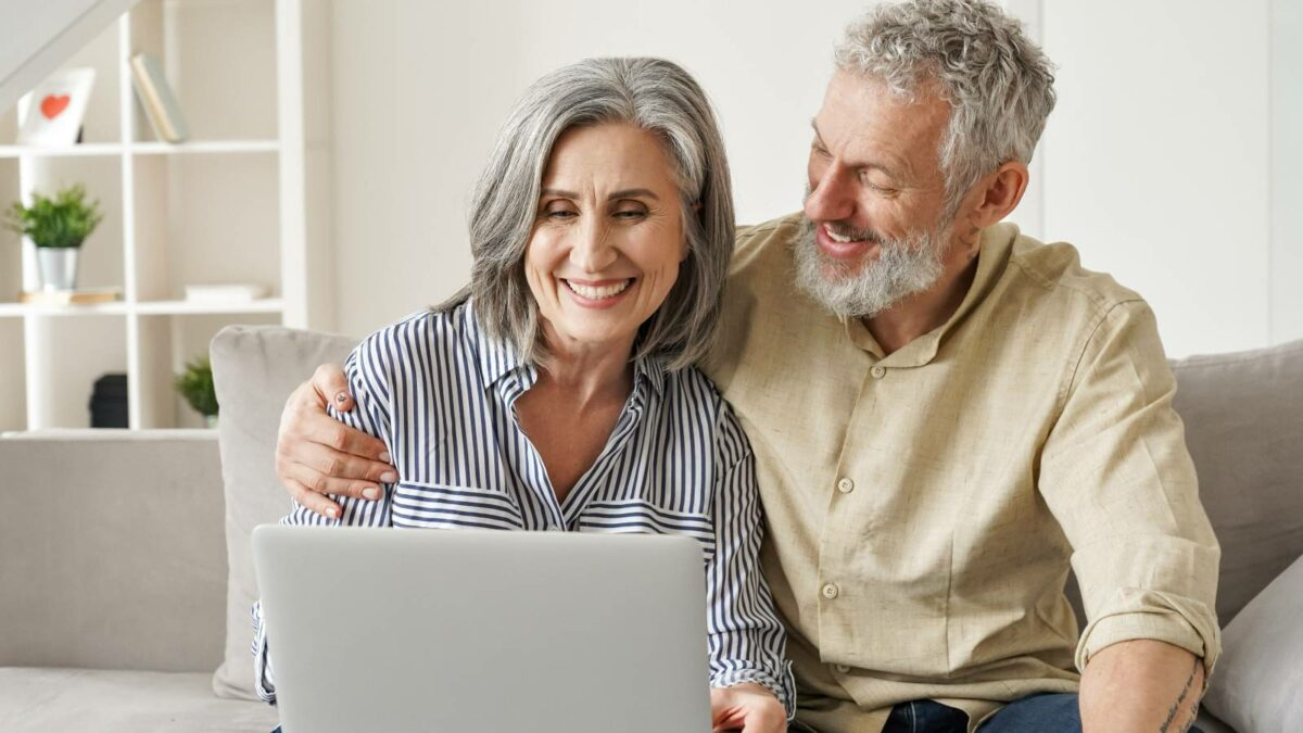 senior couple looking at a laptop together looking for senior living options