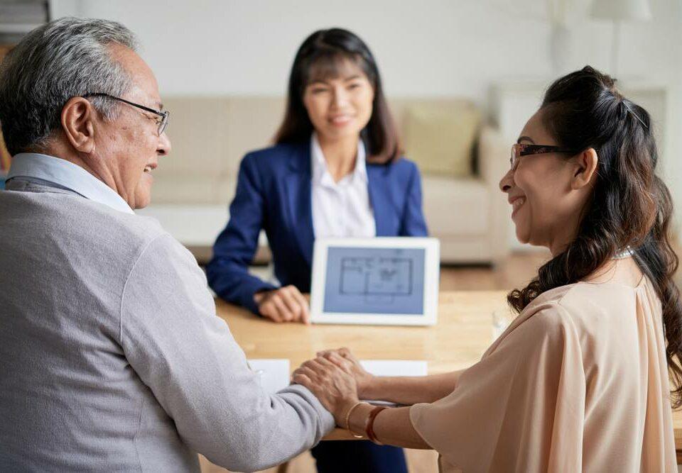a senior couple looking at senior apartment floor plan options