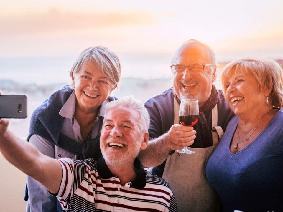 seniors enjoying their time together taking a selfie