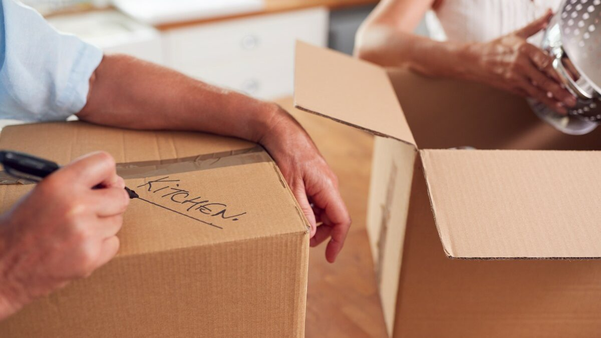 seniors packing up boxes to downsize into senior living