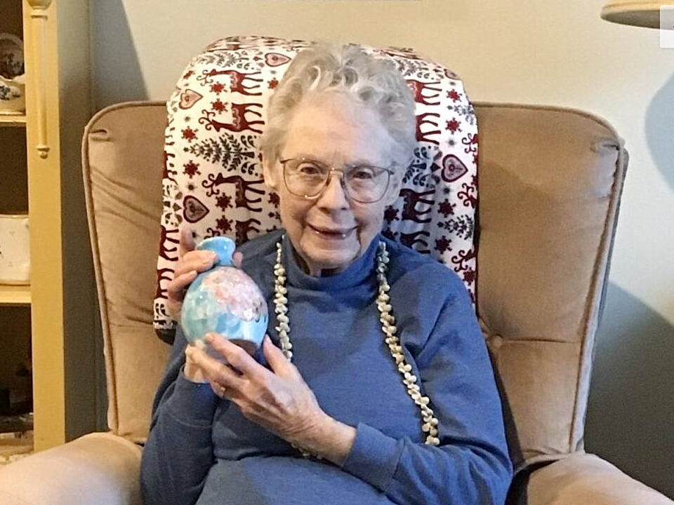 Senior woman holding a piece of pottery