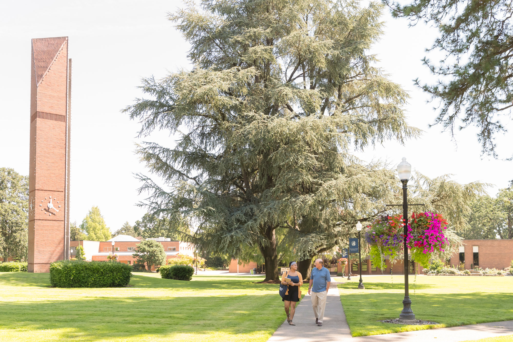 A photo of two seniors walking on campus