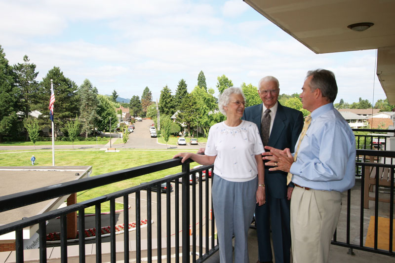 A staff member at the Friendsview retirement community talks with a senior couple