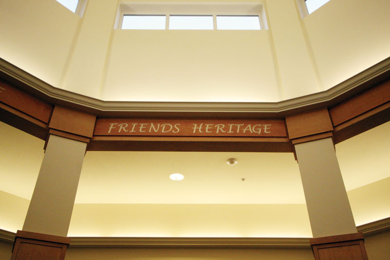 A photo of the word heritage written on the arches of a alcove