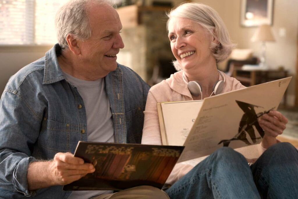 senior couple reviews records and smiles