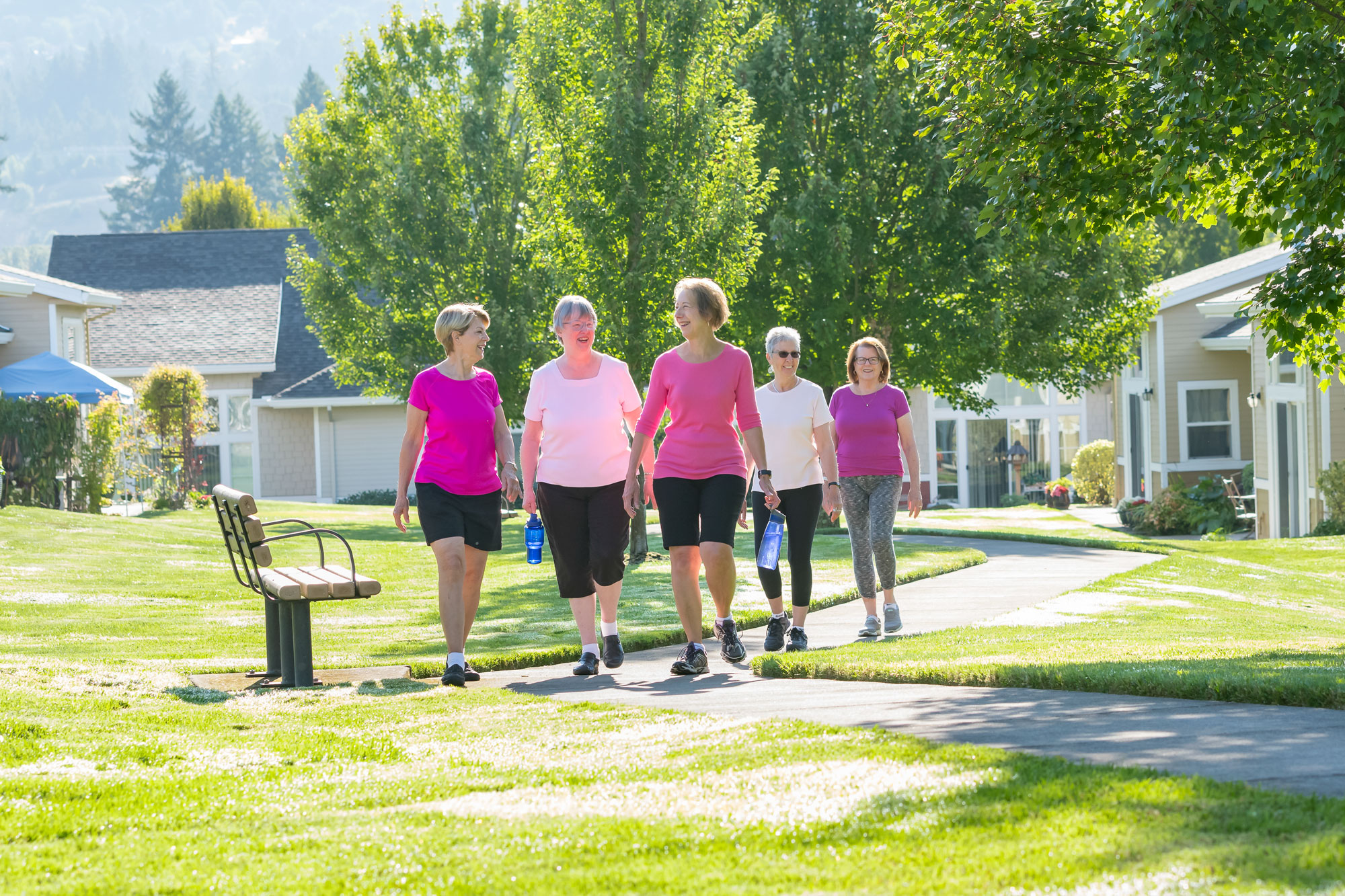 A group of senior women are walking on the campus of the Friendsview senior living community