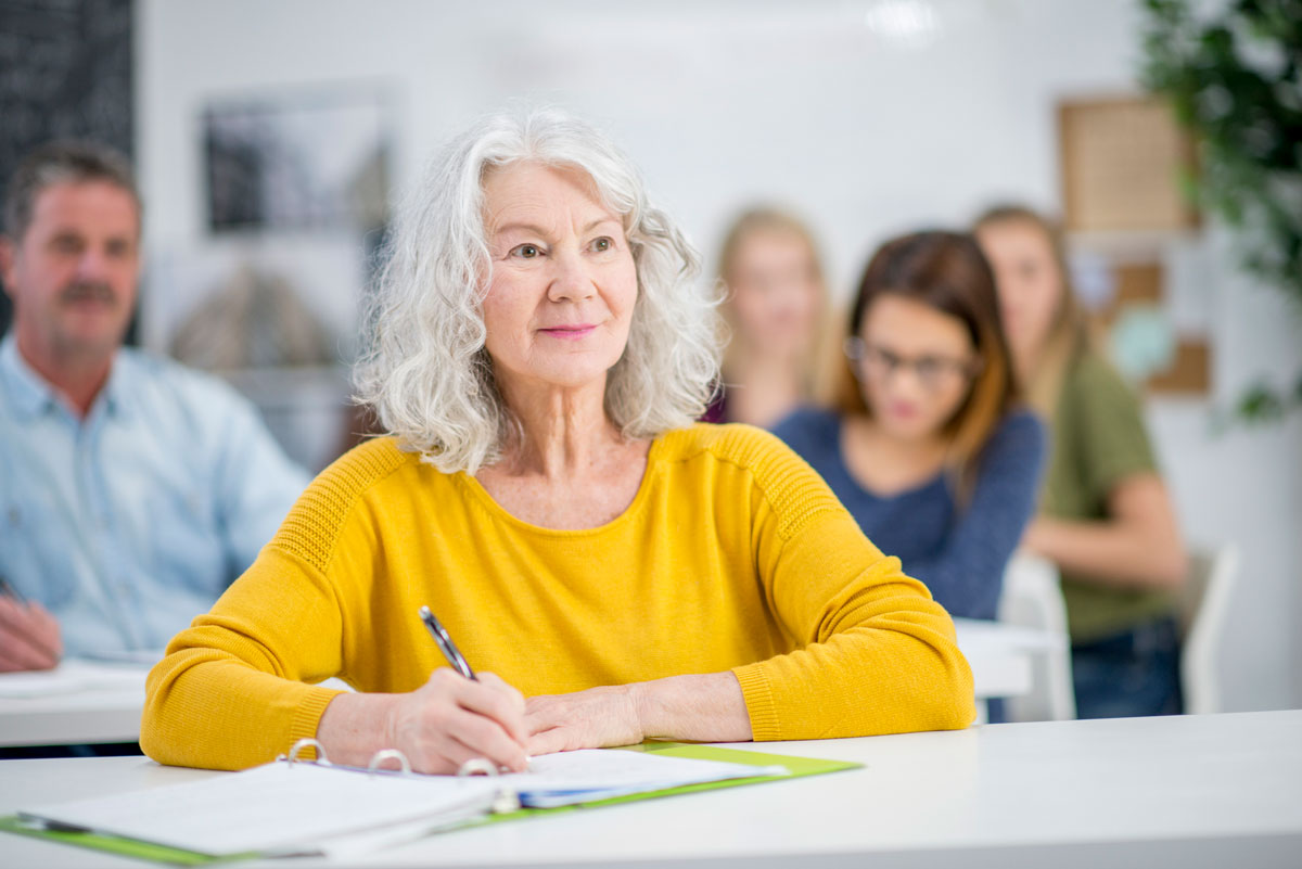 Senior woman participating in lifelong learning at a class