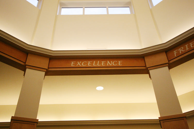 A photo of the word excellence written on the arches of a alcove