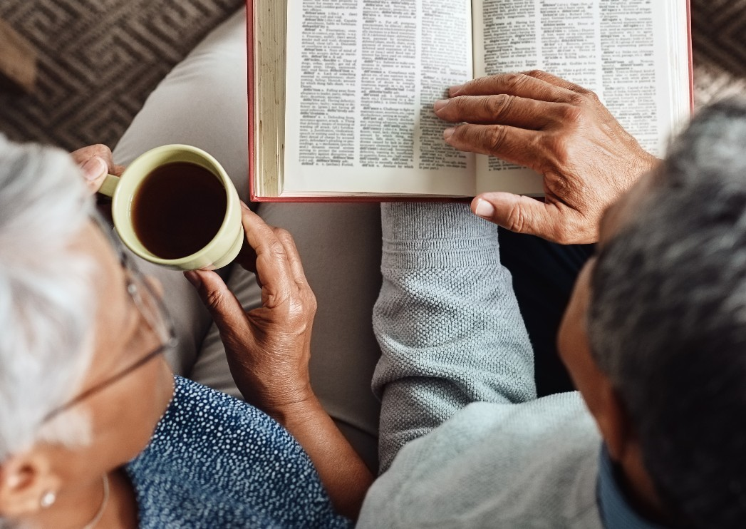 Senior couple studying the Bible