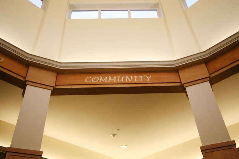 A photo of the word Community written on the arches of a alcove