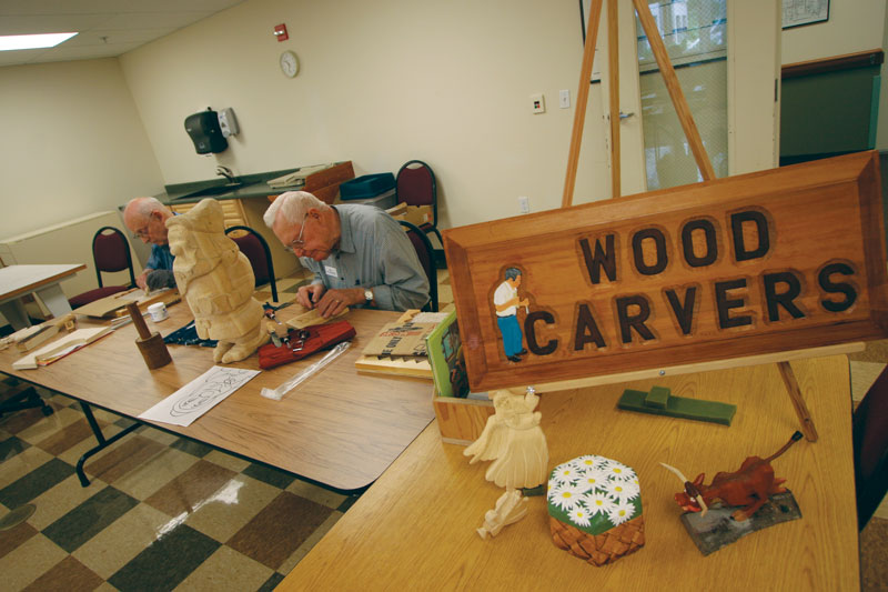 A photo of a sign that reads Wood Carvers