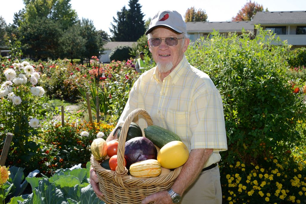 man holding veggies