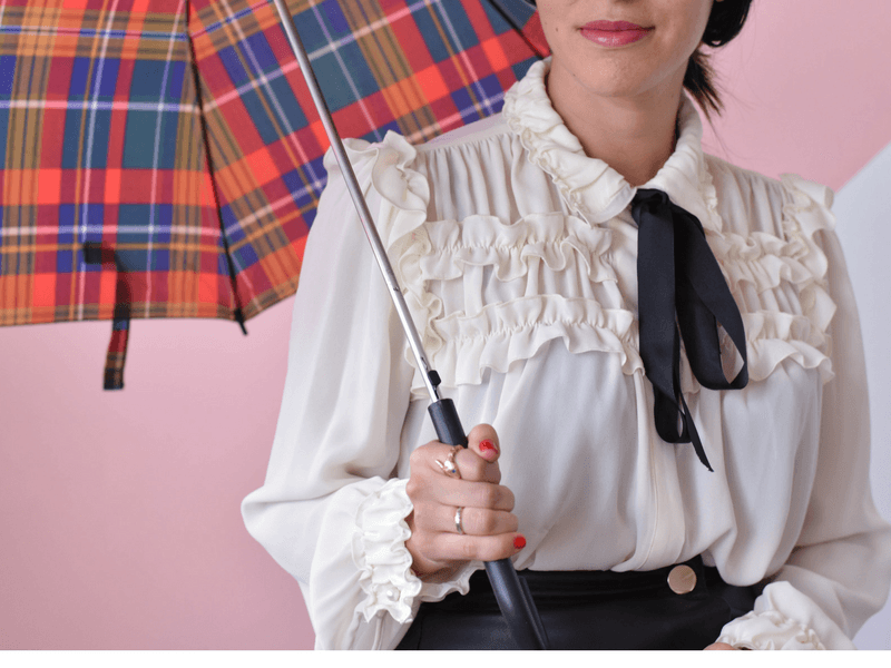 DIY Halloween Costume Ideas: Mary Poppins in opaque black tights and a black leather skirt