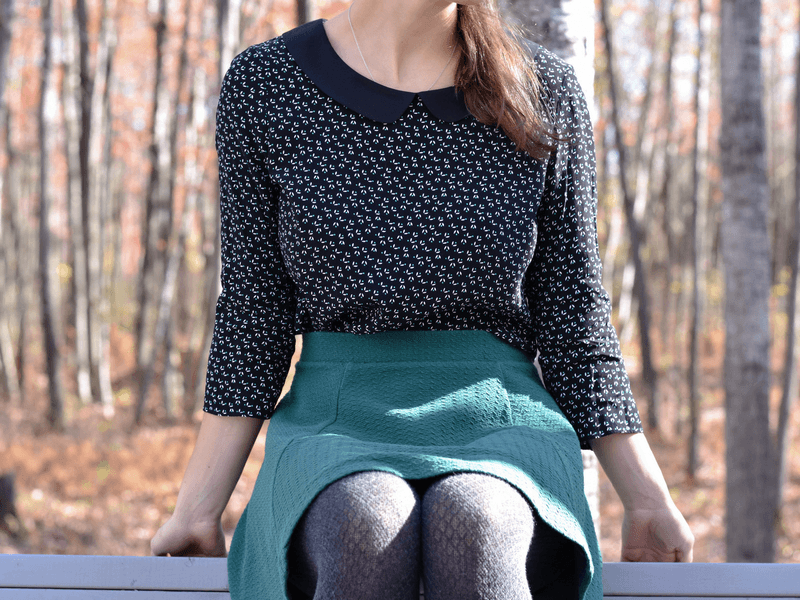 Cotton tights for the winter worn with a green skirt.