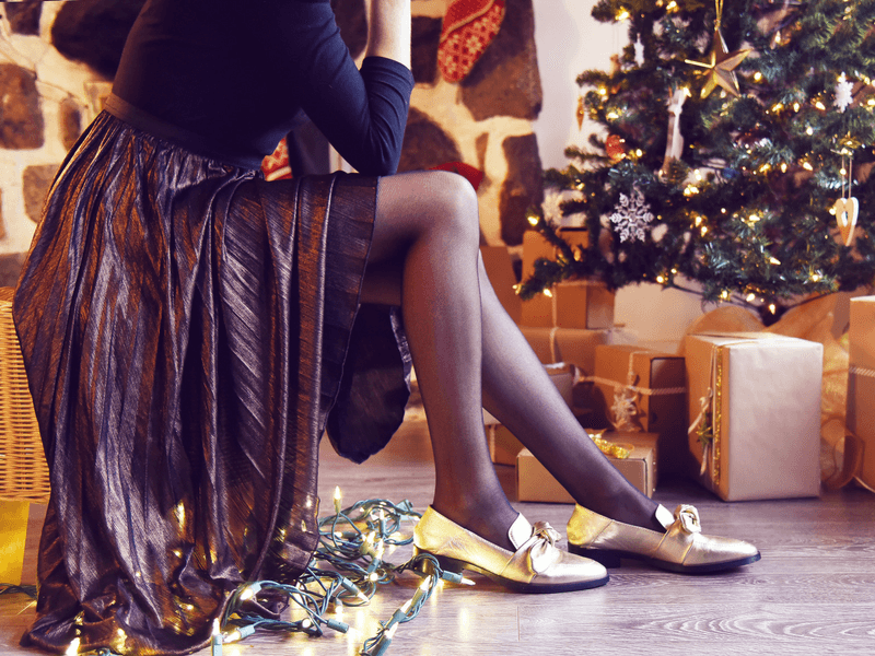 Holiday outfit ideas featuring micromesh tights worn with gold shoes.