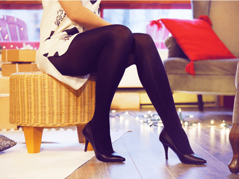 Black Opaque Diamond Tights worn with a printed white dress for the holidays.
