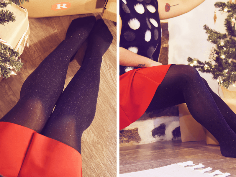 Black Opaque Diamond Tights worn with a red skirt and printed top.