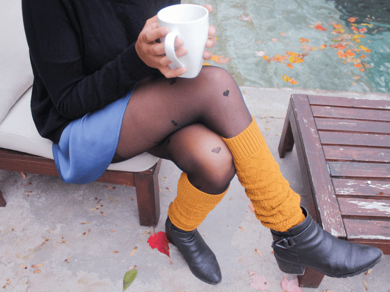 Wear leg warmers with a cozy sweater and skirt combo for a chic look thats perfect for brunch.