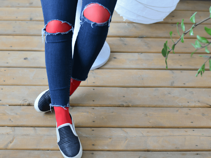 Wear red tights under your ripped jeans to wear them in the winter.
