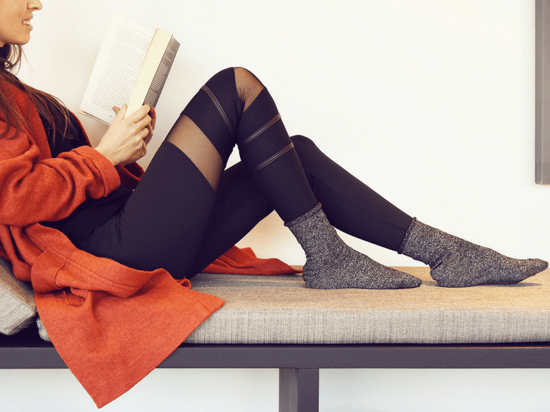 Wear a pair of leggings with a long cardigan, and complete your look with statement socks.