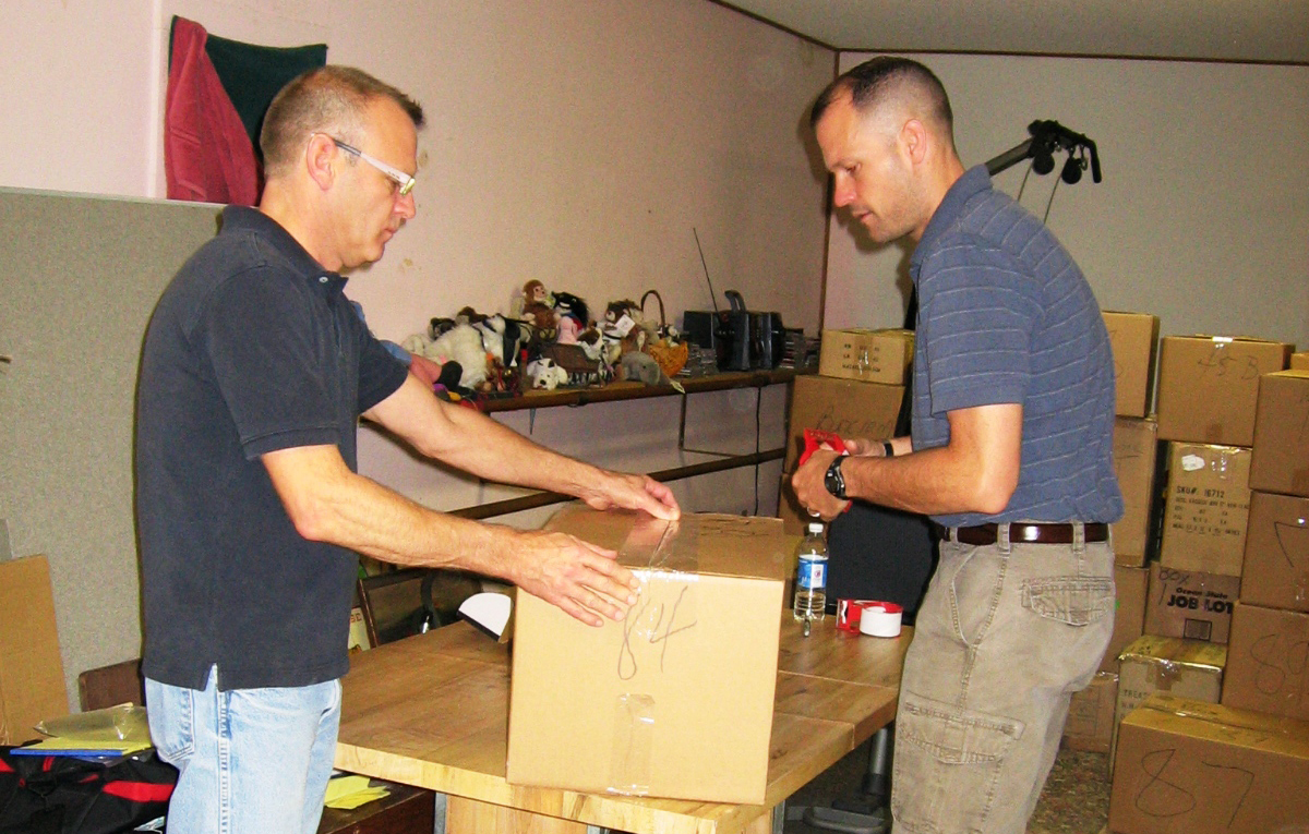 Nic and Eric demonstrate our finely-tuned teamwork in packing mode.