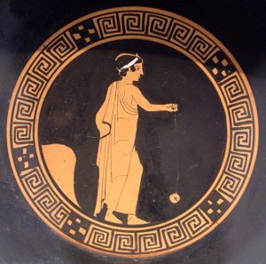 Photograph of Greek vase with image of a boy playing with yo-yo, circa 440 BC. Photo courtesy of Wikimedia Commons user Bibi Saint-Pol through Creative Commons License Attribution.