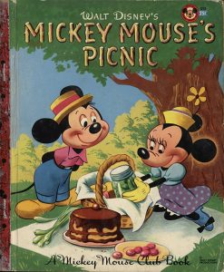 The picnic has long been portrayed in art, literature, and film as a romantic outing. The allure of being alone on a blanket with your beloved out in the wildness of nature proved irresistible to many a young adult, including Mickey Mouse. Mickey Mouse's Picnic, book, The Strong, Rochester, New York