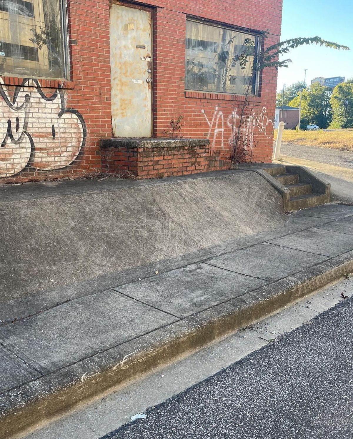 Image for skate spot 12th St - Banked Gap Over Stairs