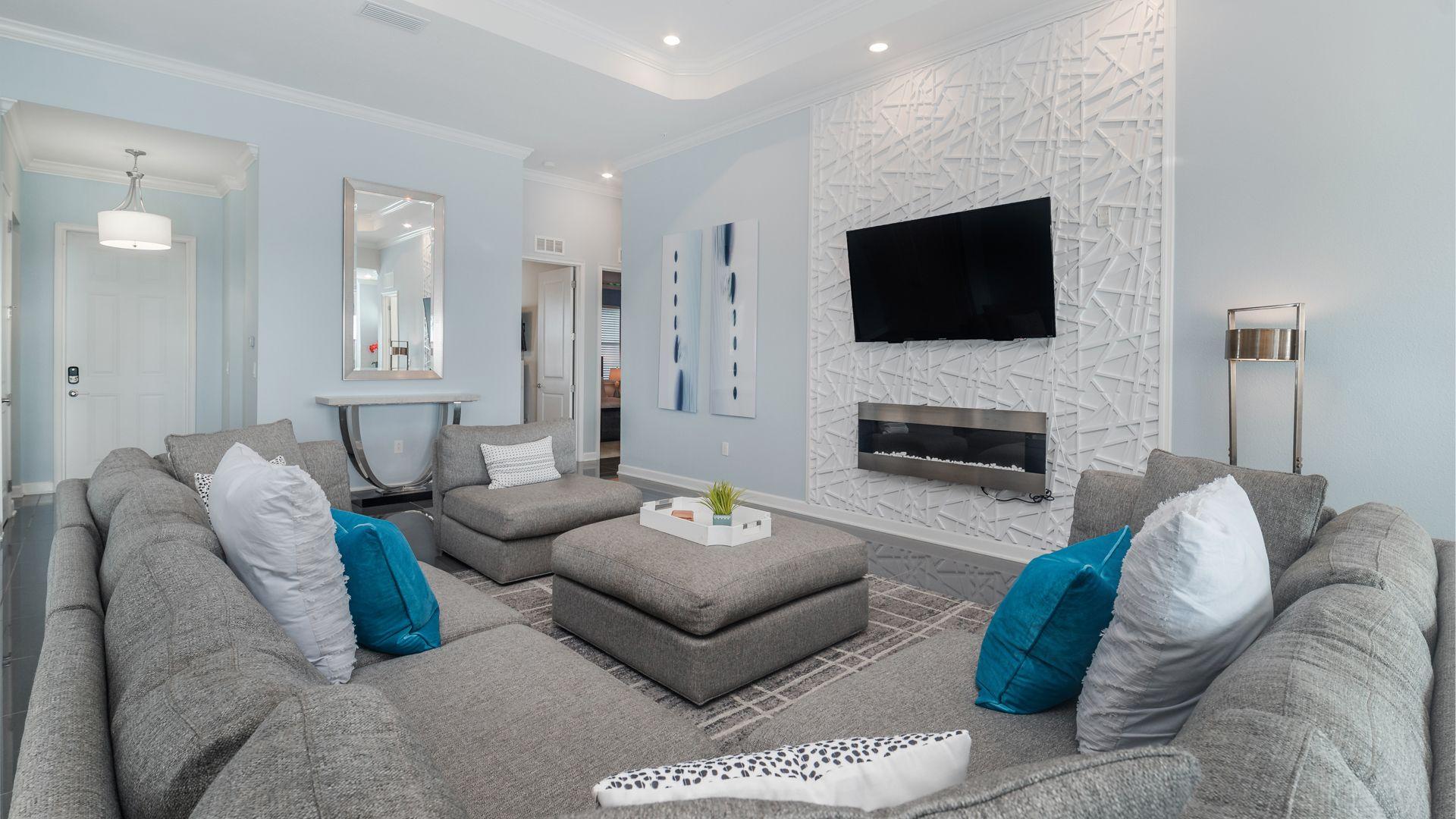 "Living Room (Angle) 65"" Roku Tv, Electric fireplace"