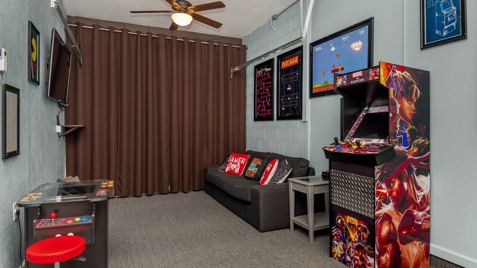 Game Room.  Marvel Video Arcade with multiple game options. Pacman Video Arcade with multiple game options.