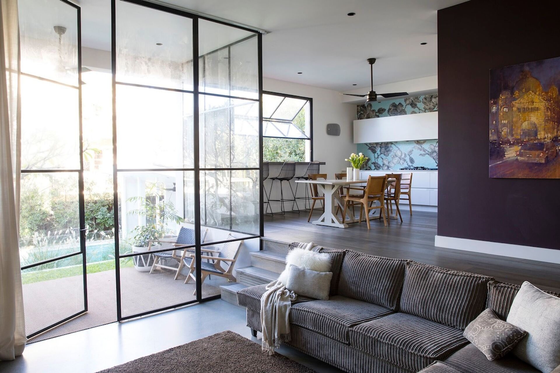 the sunken living area with views of the pool