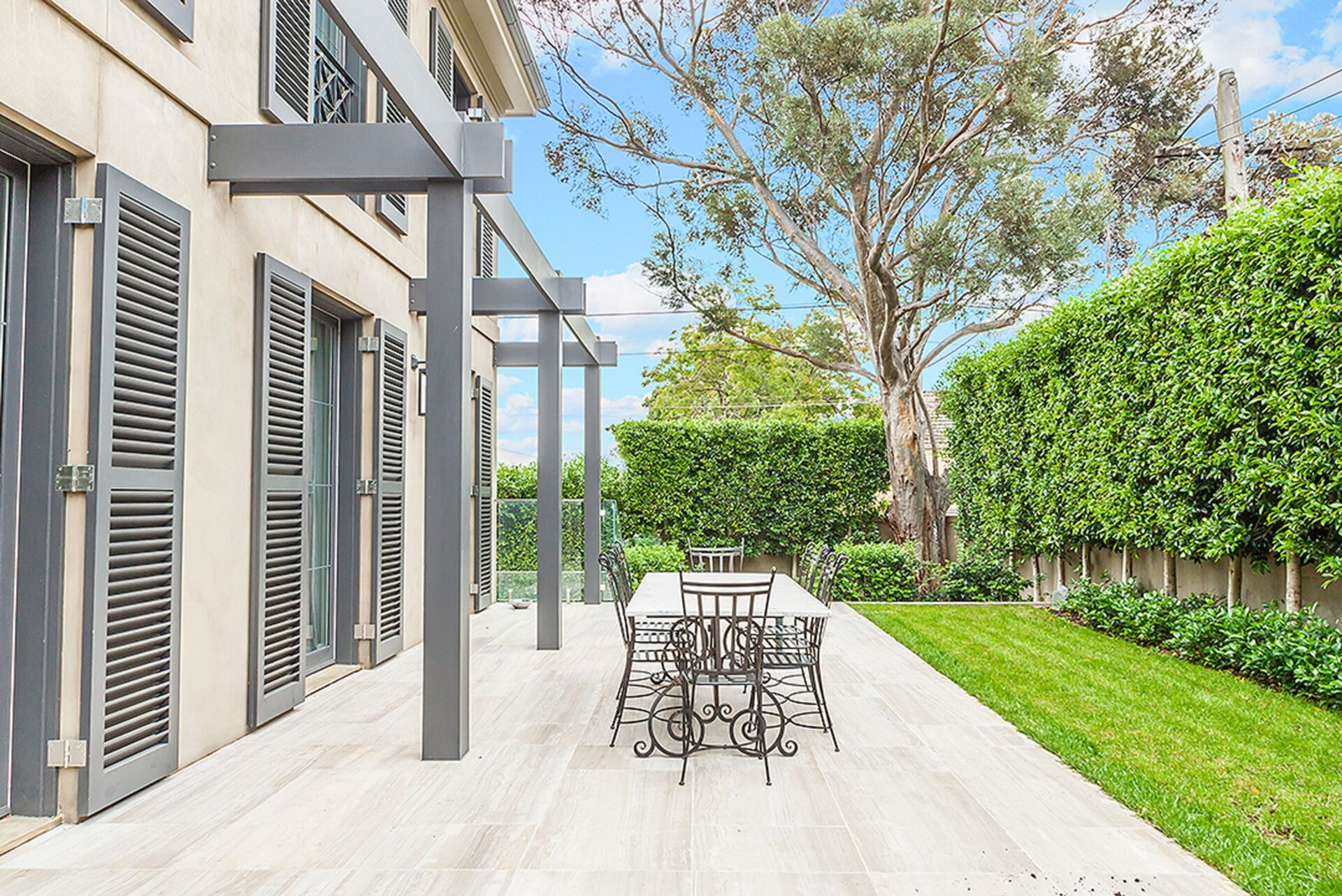 Spacious outdoor dining area with verdant garden