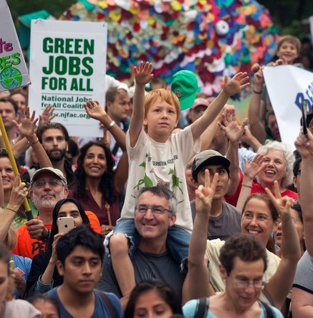 Participants in the People's Climate March make their way through the streets of New York City. The march, two-days before the United Nations Climate Summit, is billed as the largest climate march in history.  The People's Climate March is a global weekend of action on climate change. More than 2000 events are planned over 6 continents, including huge rallies in New York and London.  The summit, called by UN Secretary General Ban Ki-moon, will be attended by more than 120 world leaders and will be the largest gathering of world leaders to discuss climate change since the Copenhagen Summit in 2009.