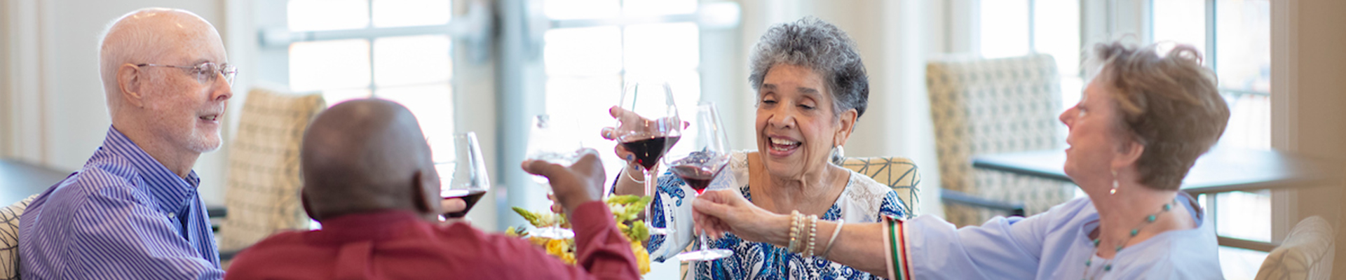 seniors toasting with their wine while at dinner