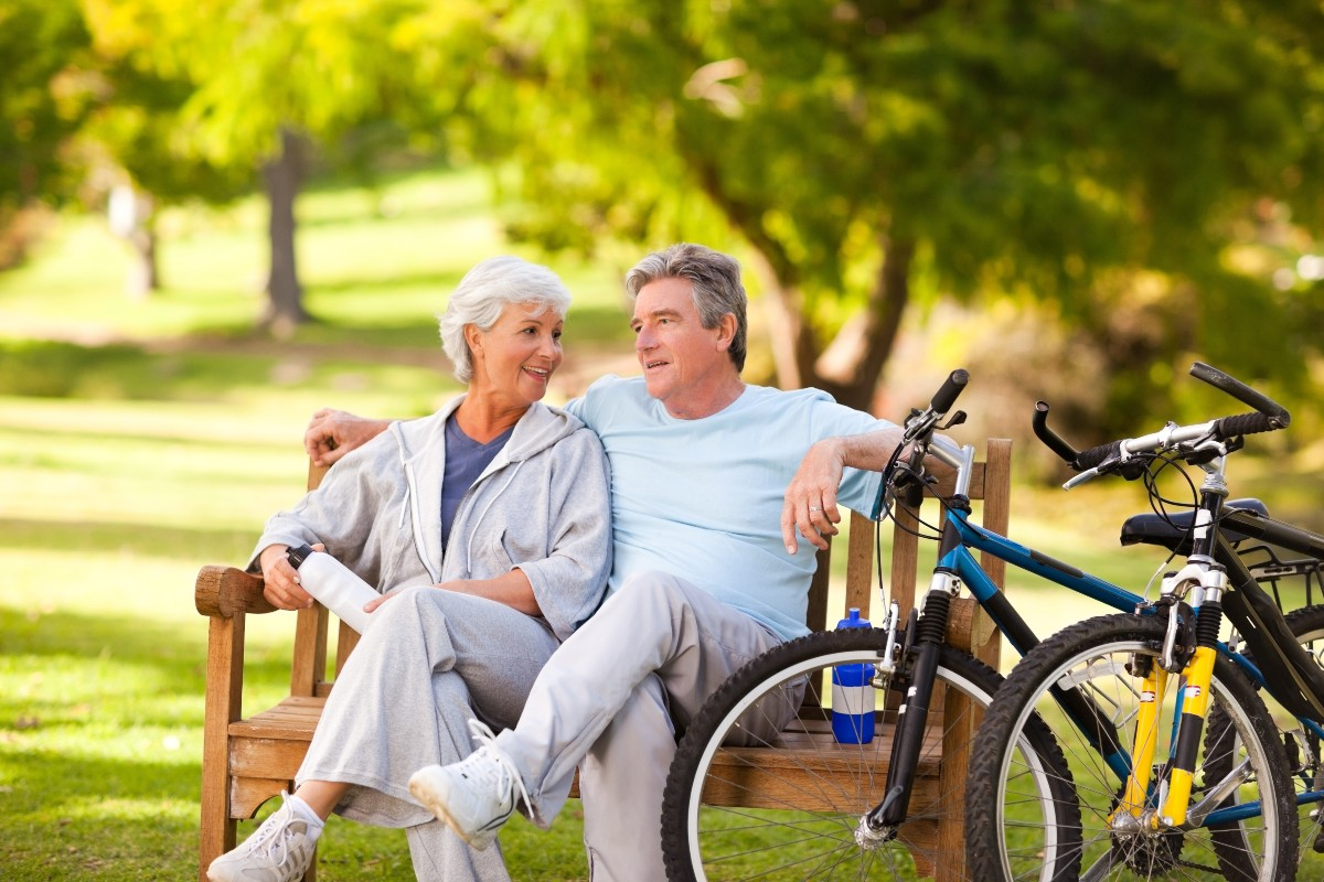 senior couple taking a break from biking