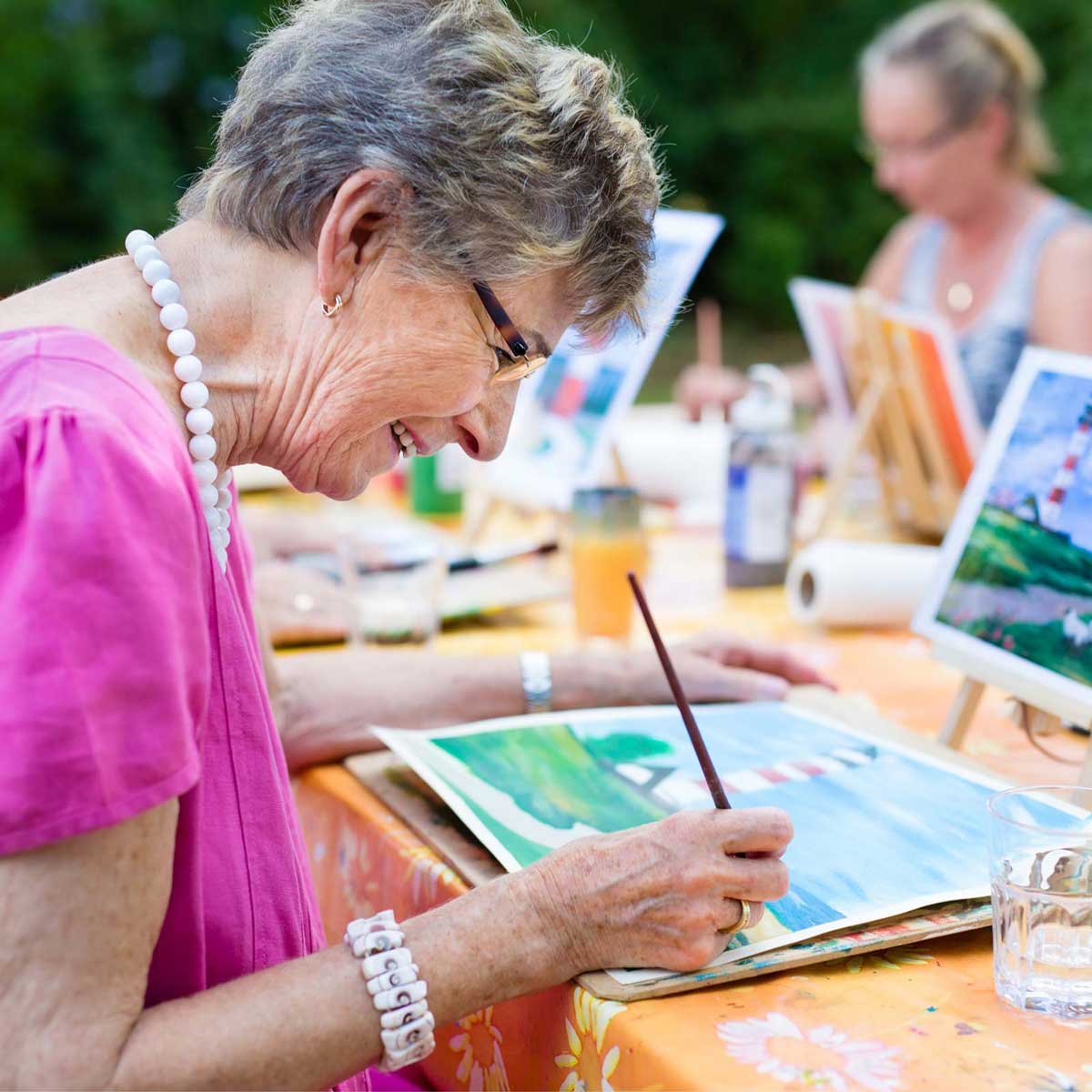 senior woman painting with watercolors