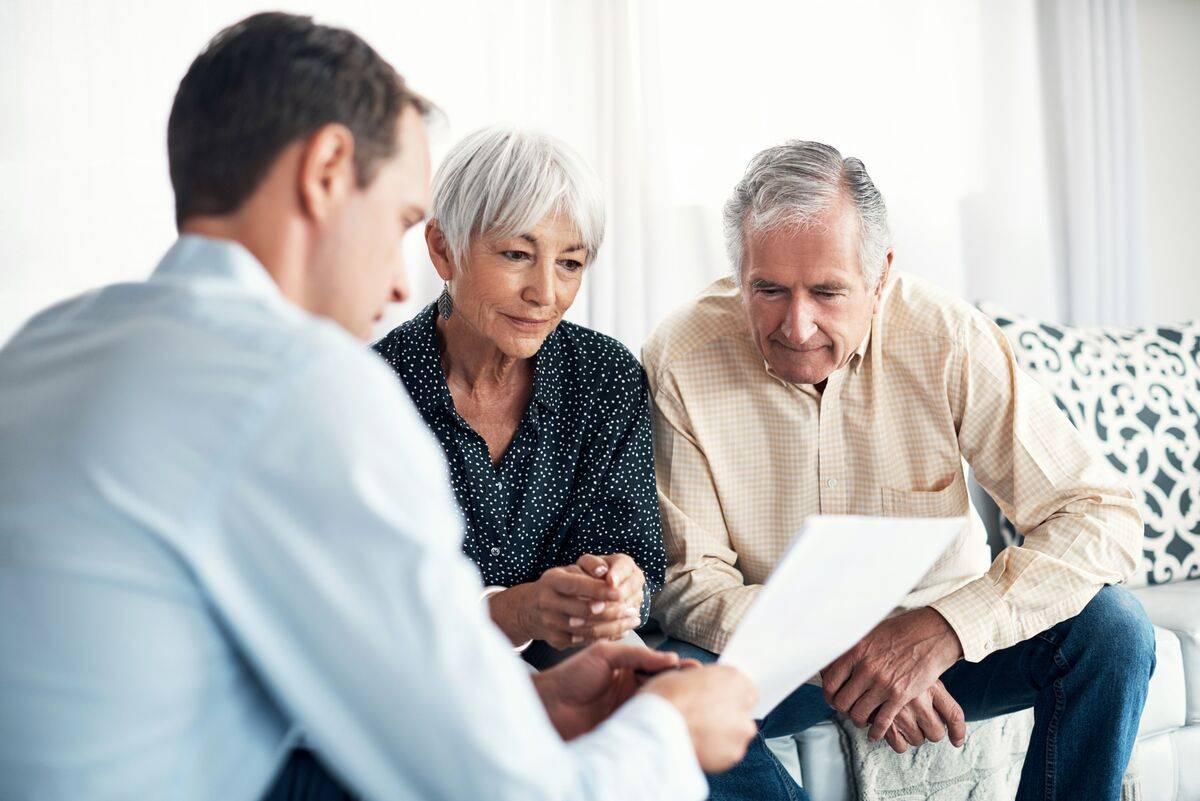senior couple looking over life care contracts