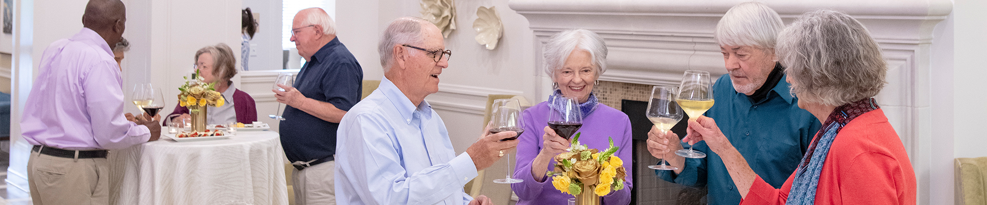 seniors at a happy hour enjoying beverages and appetizers