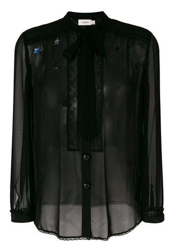 Blusa semitrasparente