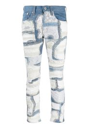 Jeans con pannelli in pizzo