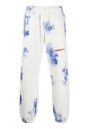 Strictly Dominant tie-dye track pants