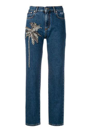 Jeans con palme decorative