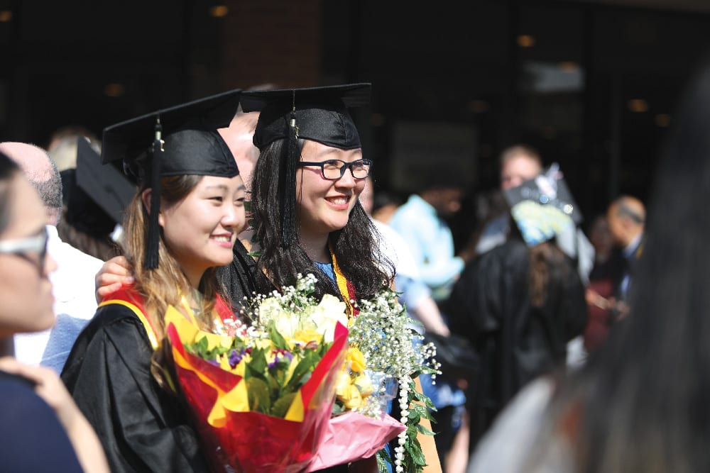 Two students graduating
