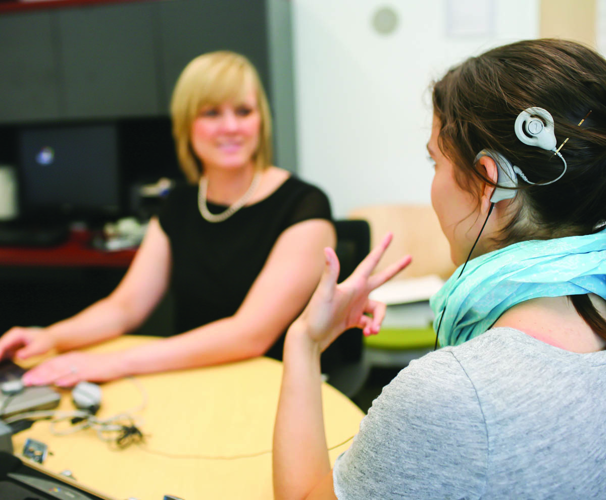 Class interaction with hearing aid device