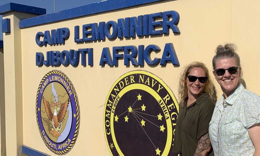 Vanessa Schaffer, NGA American Sign Language interpreter (left), and Paula Ayres, '95, NGA hybrid geospatial imagery analyst, pose for a photograph while deployed in 2020 to Djibouti, Africa.