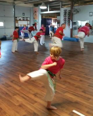 Practicing Back Kicks During Class