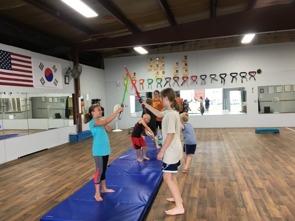 Students of Cascade Karate learn Lightsaber skills during our three day Jedi Training Camp
